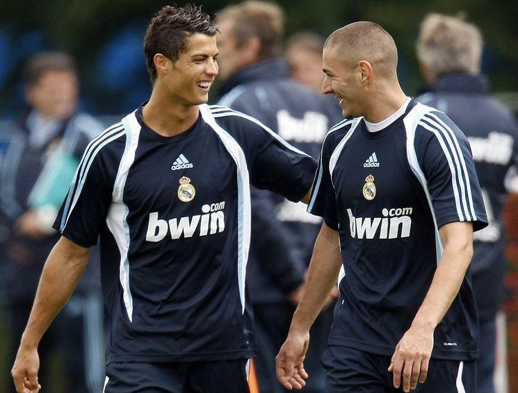 Real Madrid soccer players Ronaldo and Benzema share a joke during a training session in County Kildare