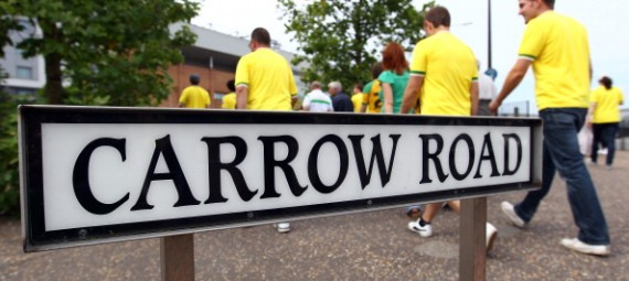 NORWICH, ENGLAND - AUGUST 21:  Fans arrive for Norwich's first home game before the Barclay's premier league match between Norwich and Stoke City at Carrow Road on August 21, 2011 in Norwich, England.  (Photo by Julian Finney/Getty Images)