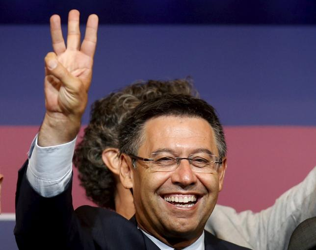 Barcelona's President Josep Maria Bartomeu celebrates his victory after being re-elected to lead the triple winners for the next six years after a vote on Saturday, beating former incumbent Joan Laporta, in Barcelona, Spain, late July 18, 2015. REUTERS/Albert Gea