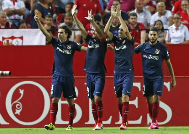Atletico Madrid's Gabi (2nd L) celebrates with teammates after scoring against Sevilla during their Spanish first division soccer match at Ramon Sanchez Pizjuan stadium in Seville, southern Spain, August 30, 2015. REUTERS/Marcelo del Pozo