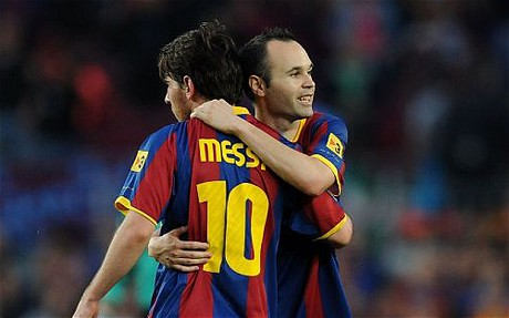 Barcelona v Espanyol - La Liga...BARCELONA, SPAIN - MAY 08: Andres Iniesta (R) of Barcelona celebrates with Lionel Messi after Barcelona beat Espanyol 2-0 in the La Liga match at Nou Camp on May 8, 2011 in Barcelona, Spain.  (Photo by Denis Doyle/Getty Images)