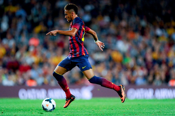 BARCELONA, SPAIN - OCTOBER 05:  Neymar of FC Barcelona runs with the ball during the La Liga match between FC Barcelona and Real Valladolid CF at Camp Nou on October 5, 2013 in Barcelona, Spain.  (Photo by David Ramos/Getty Images)